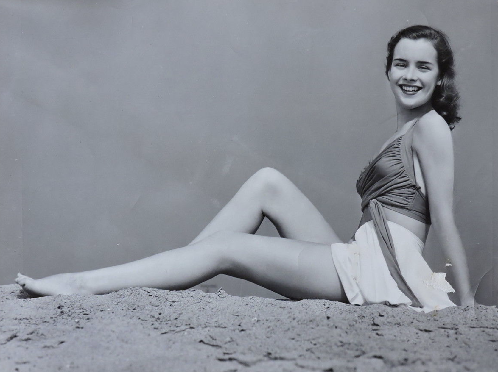 A promotional image of Susan on the beach, circa 1940s