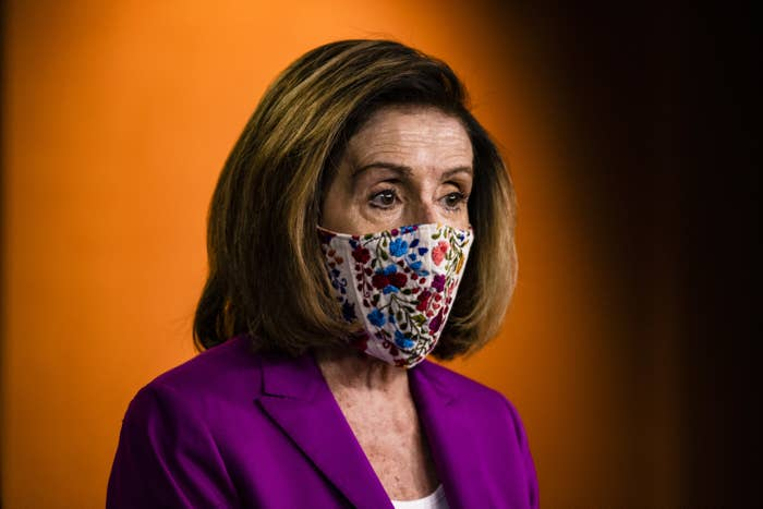 Pelosi wears a face mask as she speaks to the press