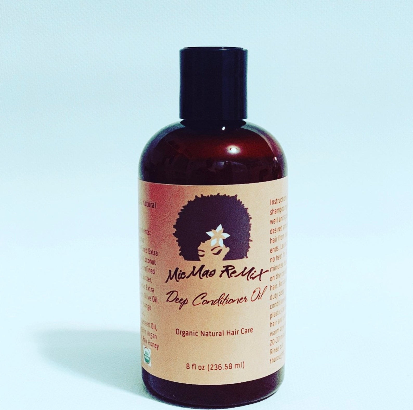 A bottle of the deep conditioner oil