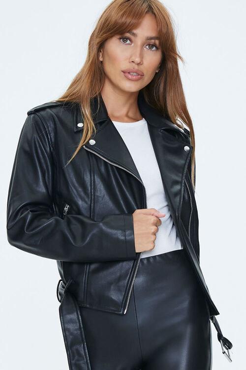 Model in faux leather moto jacket