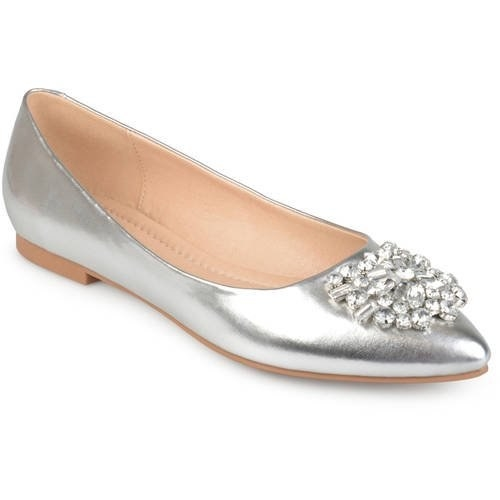 A silver pair of pointed flats with gem detail at the top