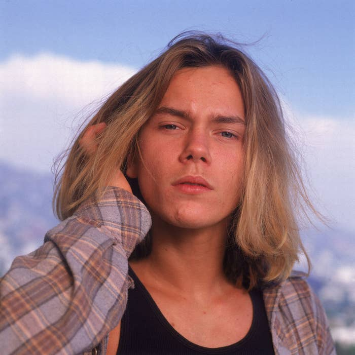 River Phoenix with long hair and wearing a flannel. It was the '90s after all.