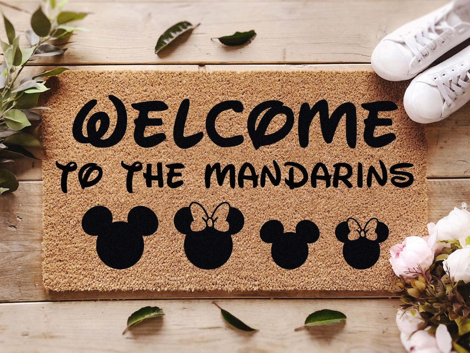"a doormat that says ""welcome to the mandarins"" with a mickey or minnie icon to represent each family member"