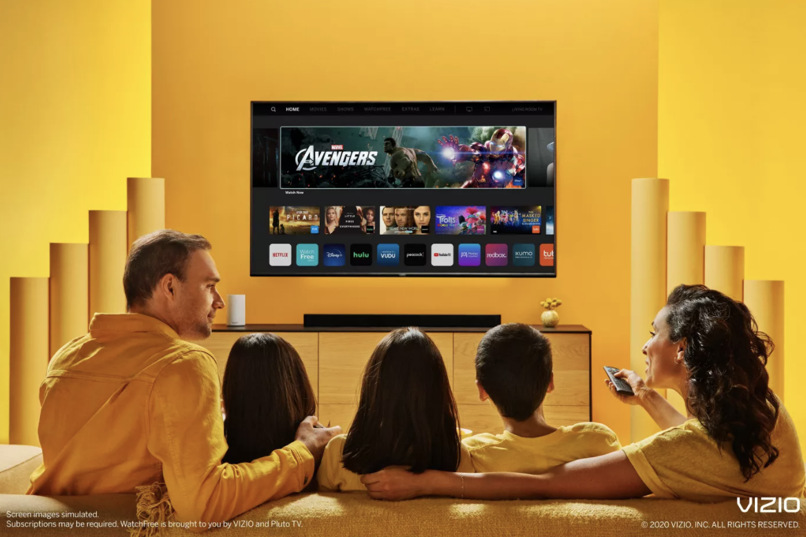a family sitting around the tv
