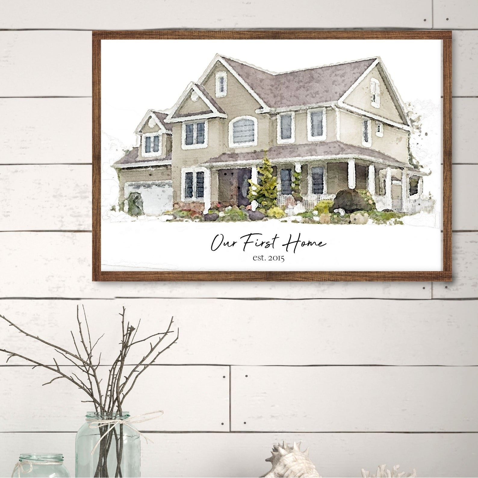 a watercolor depiction of a house in a frame