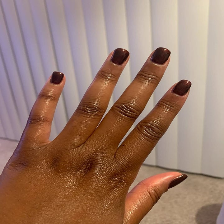 Reviewer wearing rich brown color