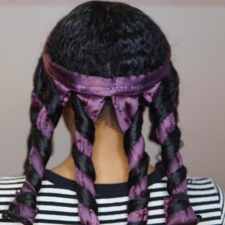 Reviewer with 3B/3C hair wrapped around the octocurl, which is wrapped around their head