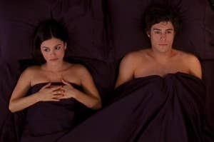 Seth and Summer from The O.C. looking disappointed in bed.