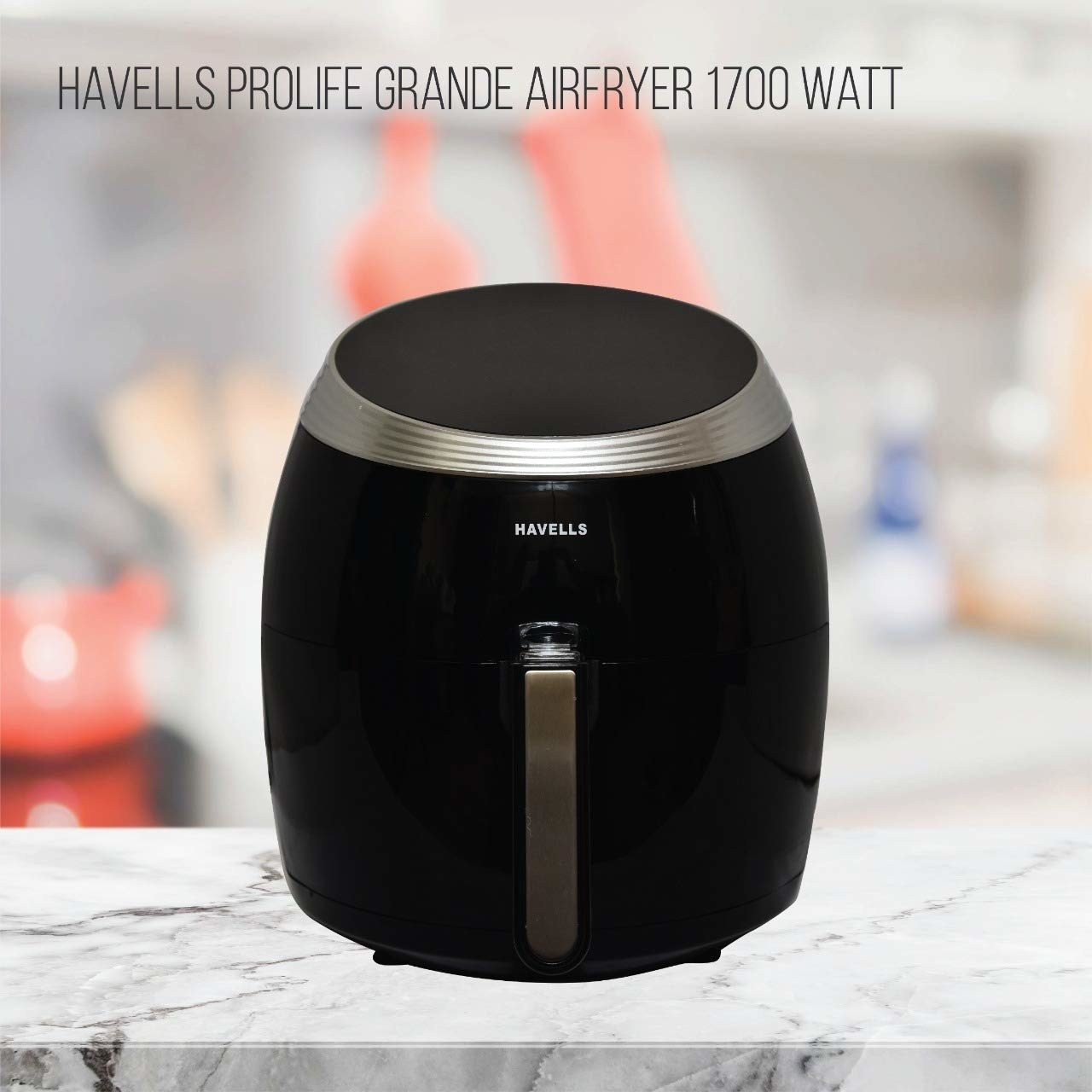 A black air fryer on a table