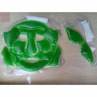 A green face and eye mask on a table