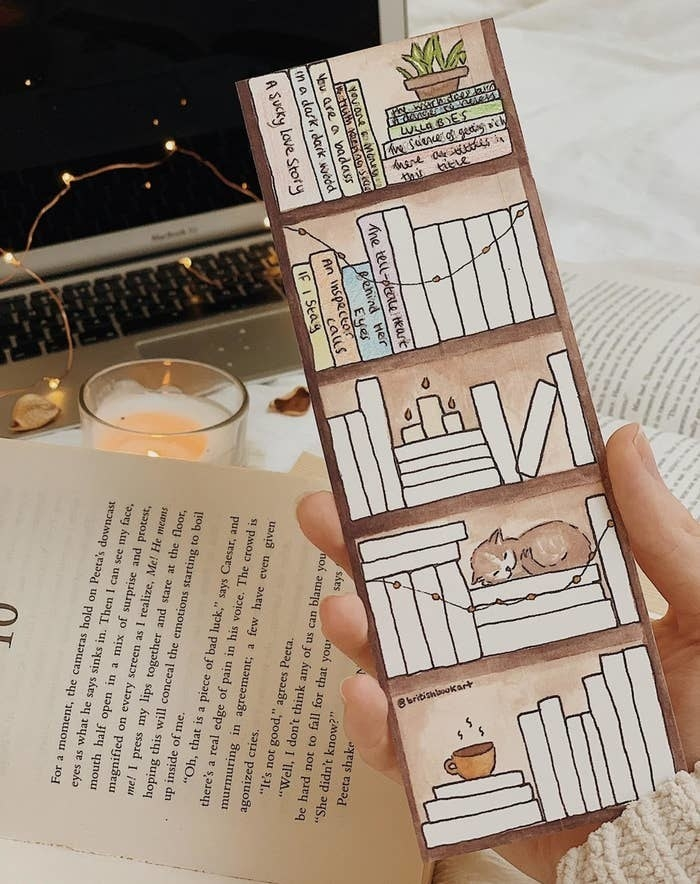 a person holding the bookmark