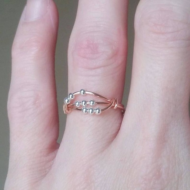 A person wearing the ring