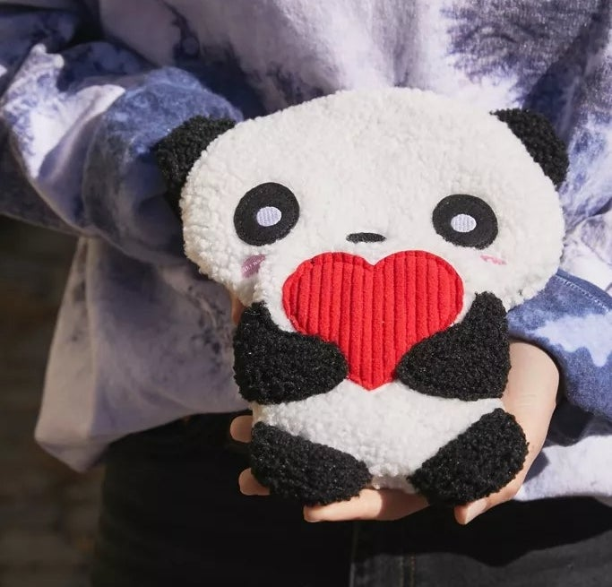 A close up of the panda pad, held up by a model