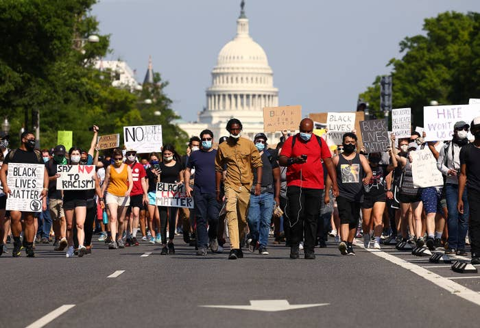 Protestors walking down Pennsylvania Avenue in front of the Capitol