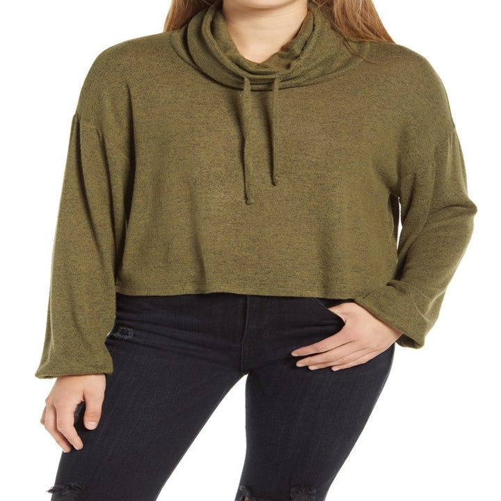 model wearing the olive green sweater