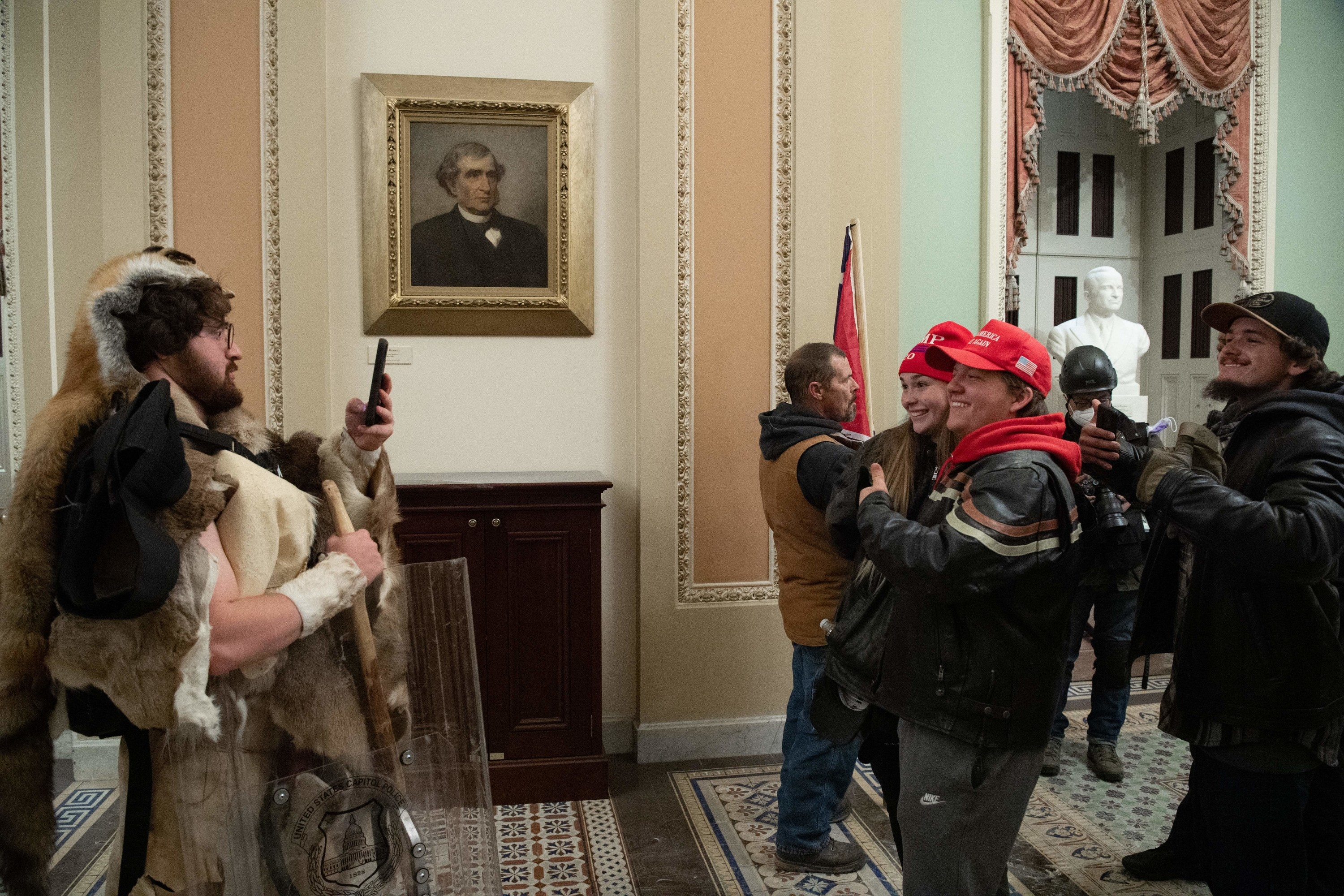 Trump supporters posing for a picture inside the Capitol