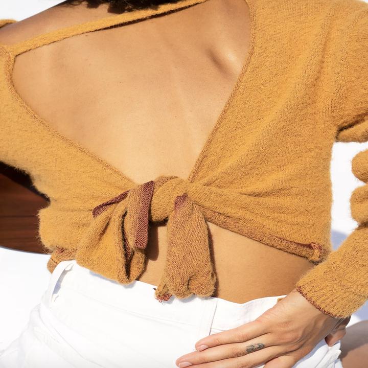 model wearing the open back sweater