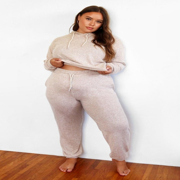 model wearing the matching hoodie and pants