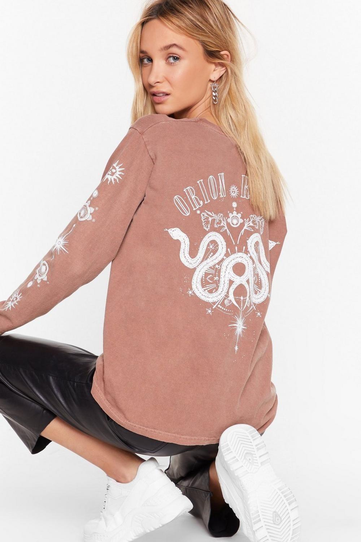 model wearing pink graphic shirt