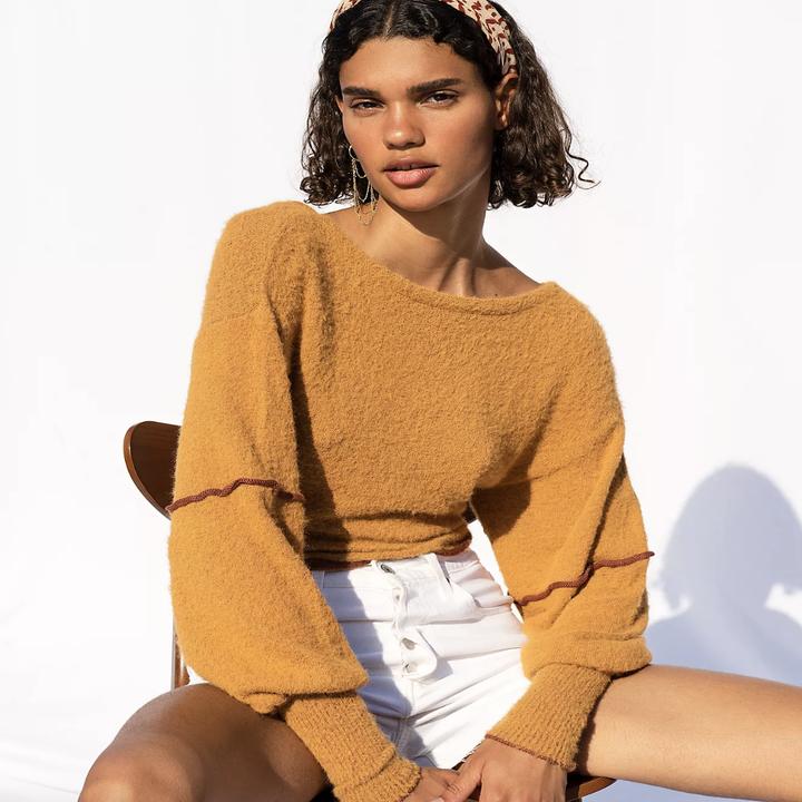 model wearing the light orange sweater