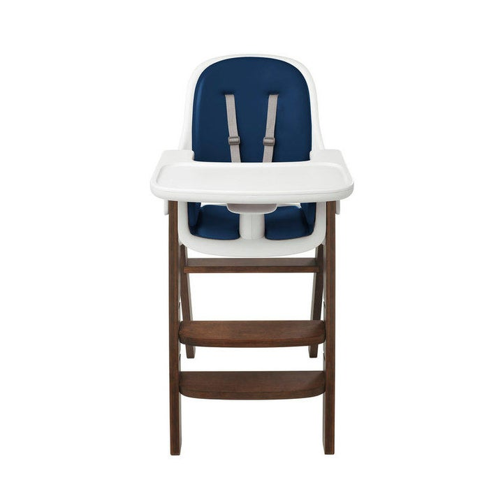 a high chair with a navy chair and walnut wooden legs