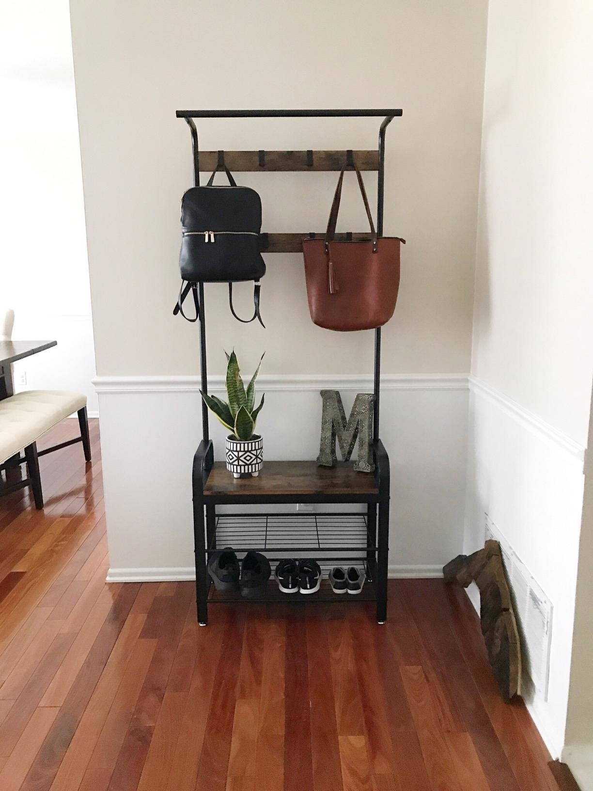 reviewer image of the VASAGLE Coat Rack in a customer's entryway