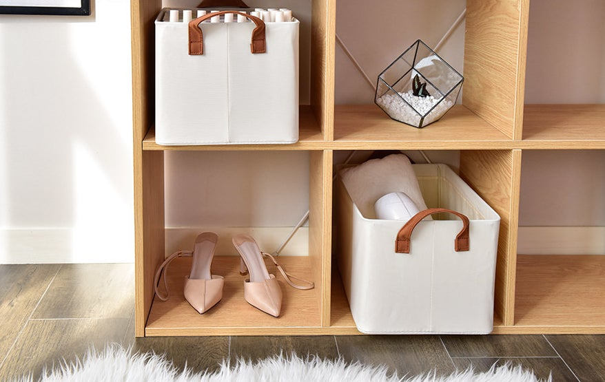 two storageworks storage bins in a cube storage unit