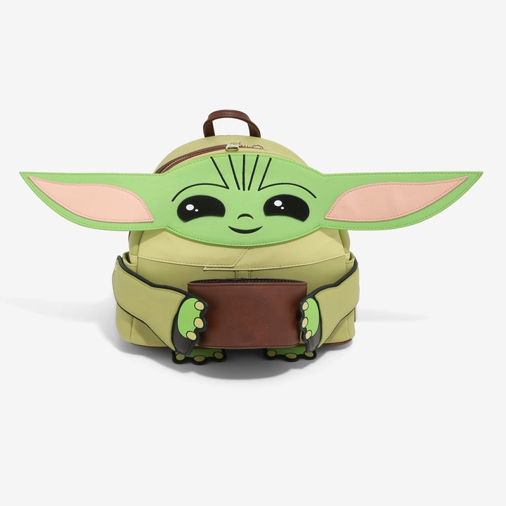a backpack with baby yoda on the back holding a soup cup