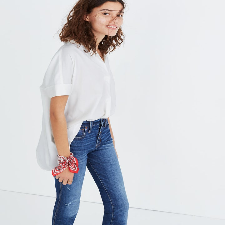 Front view of a model wearing the white collared shirt