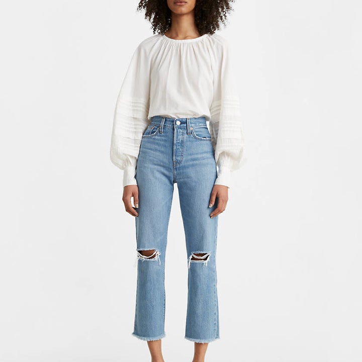 Front view of a model wearing the jeans in medium wash
