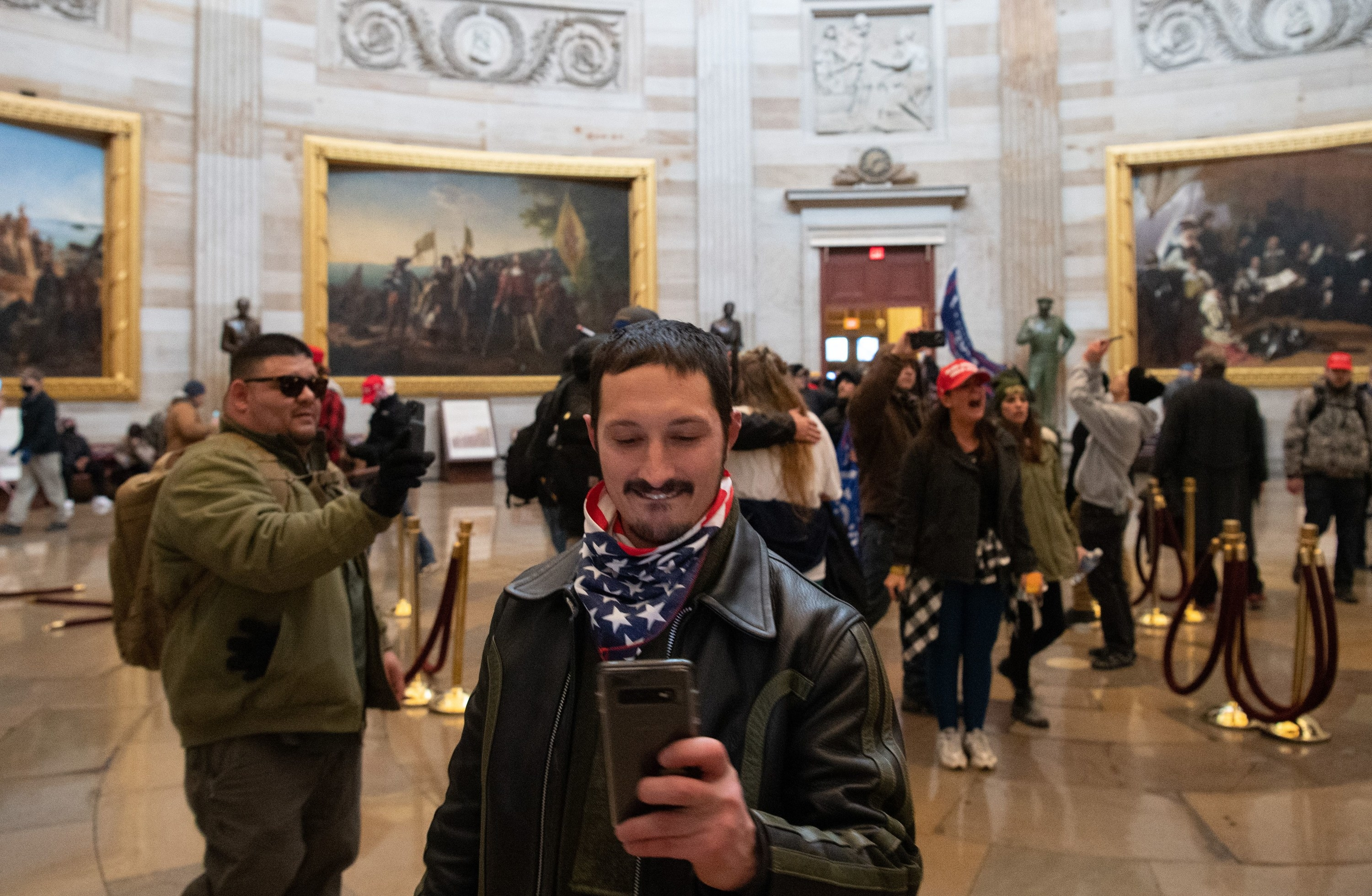 A Trump supporter taking a picture of the photo's photographer in the Capitol Rotunda