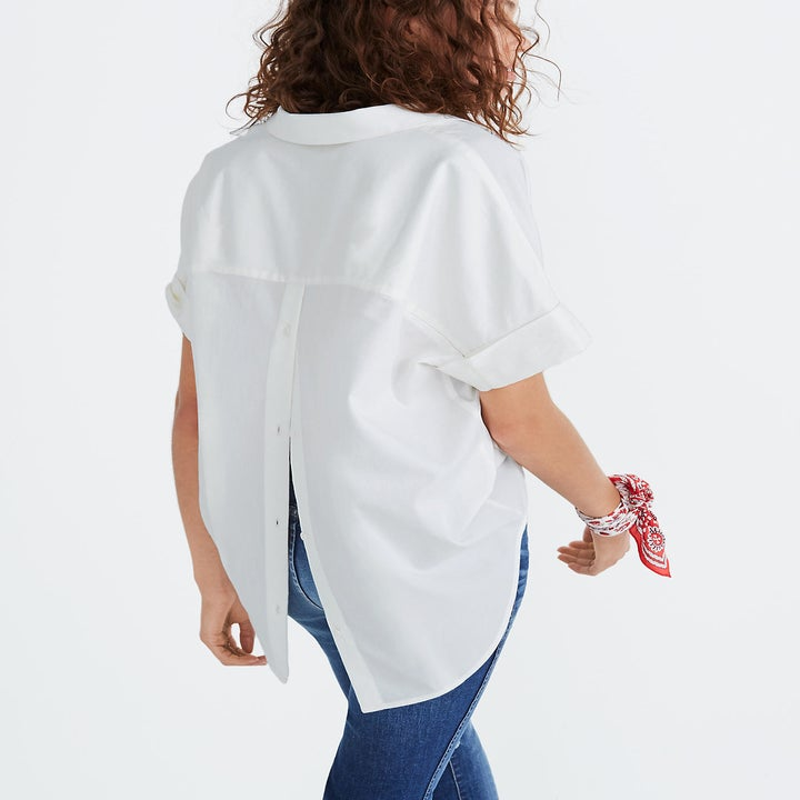 Back view of a model wearing the white collared shirt
