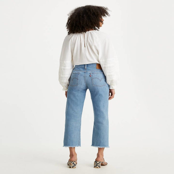 Back view of a model wearing the jeans in medium wash