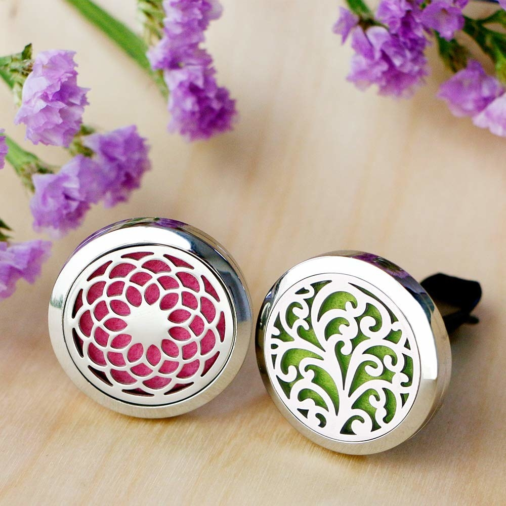the diffuser you clip on your car vent in pink and green with a floral design on the front