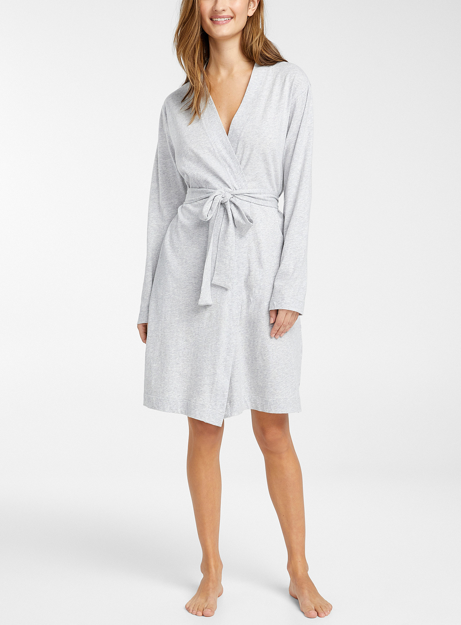 person standing with the bathrobe on