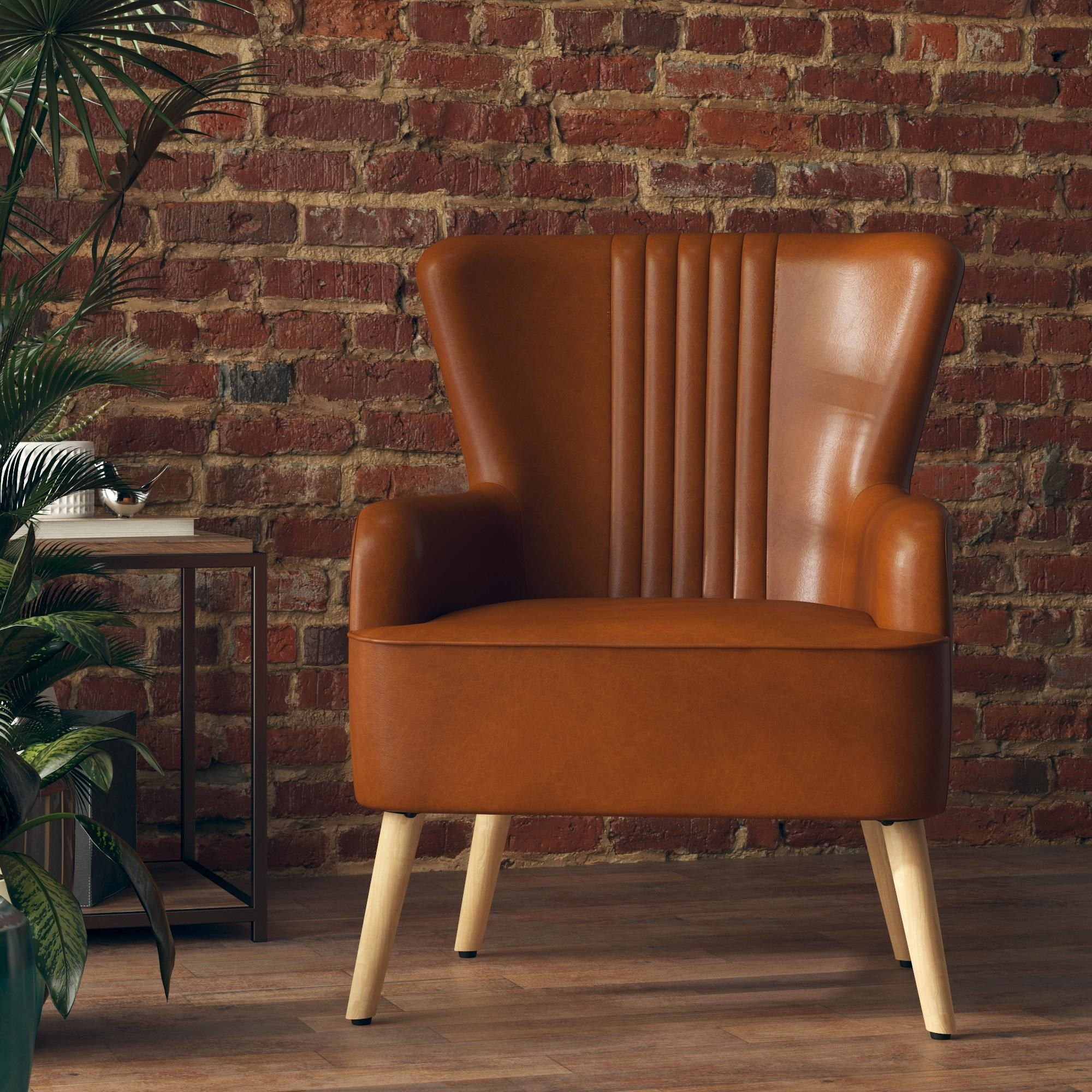 The caramel faux-leather chair which has four wooden legs and a high back