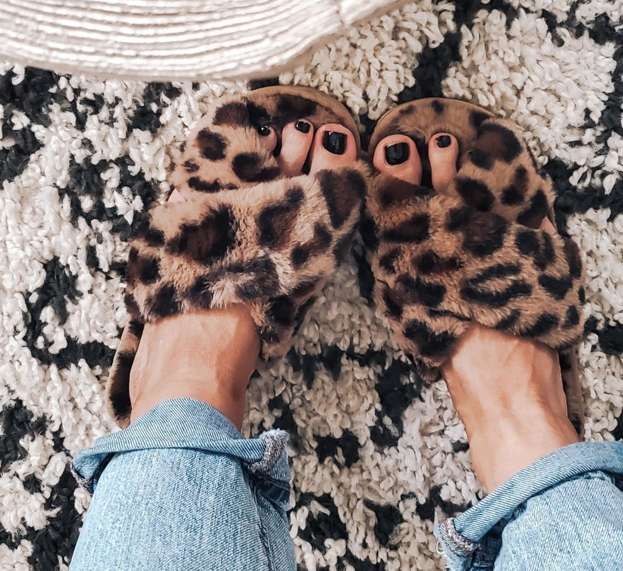 reviewer wearing leopard slippers