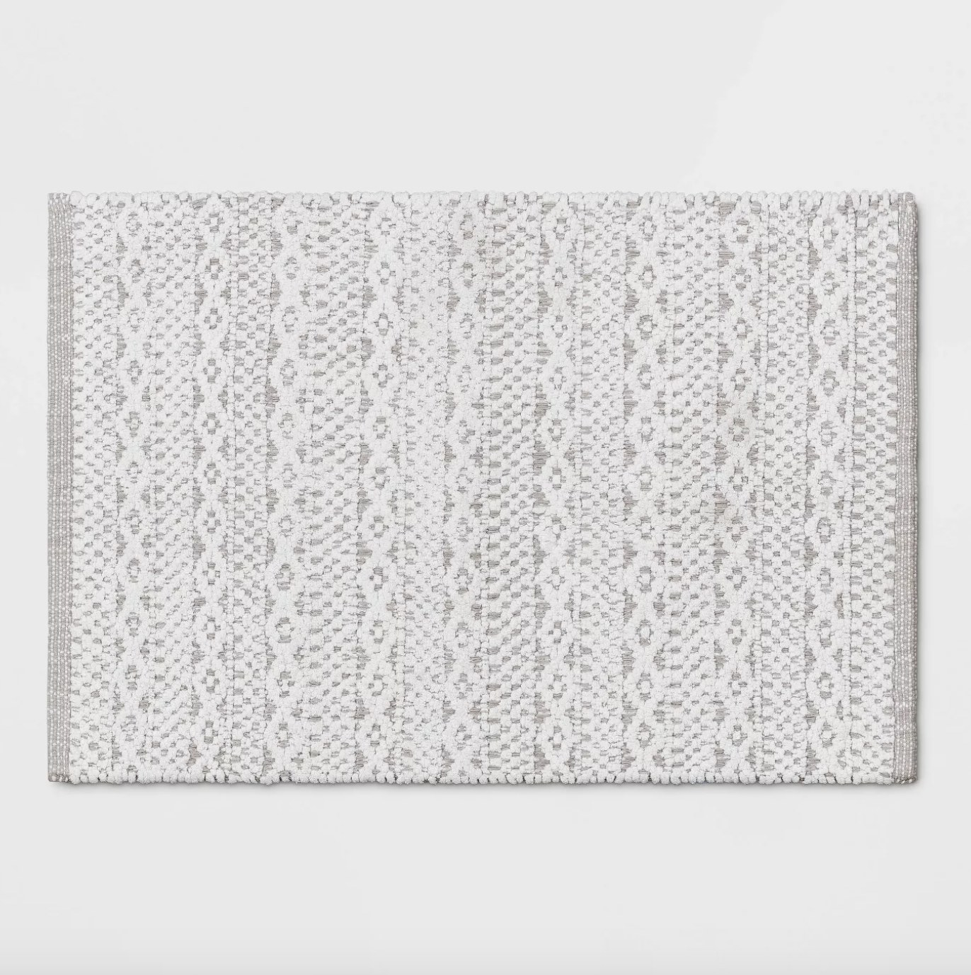 the rug in gray with a woven pattern in white