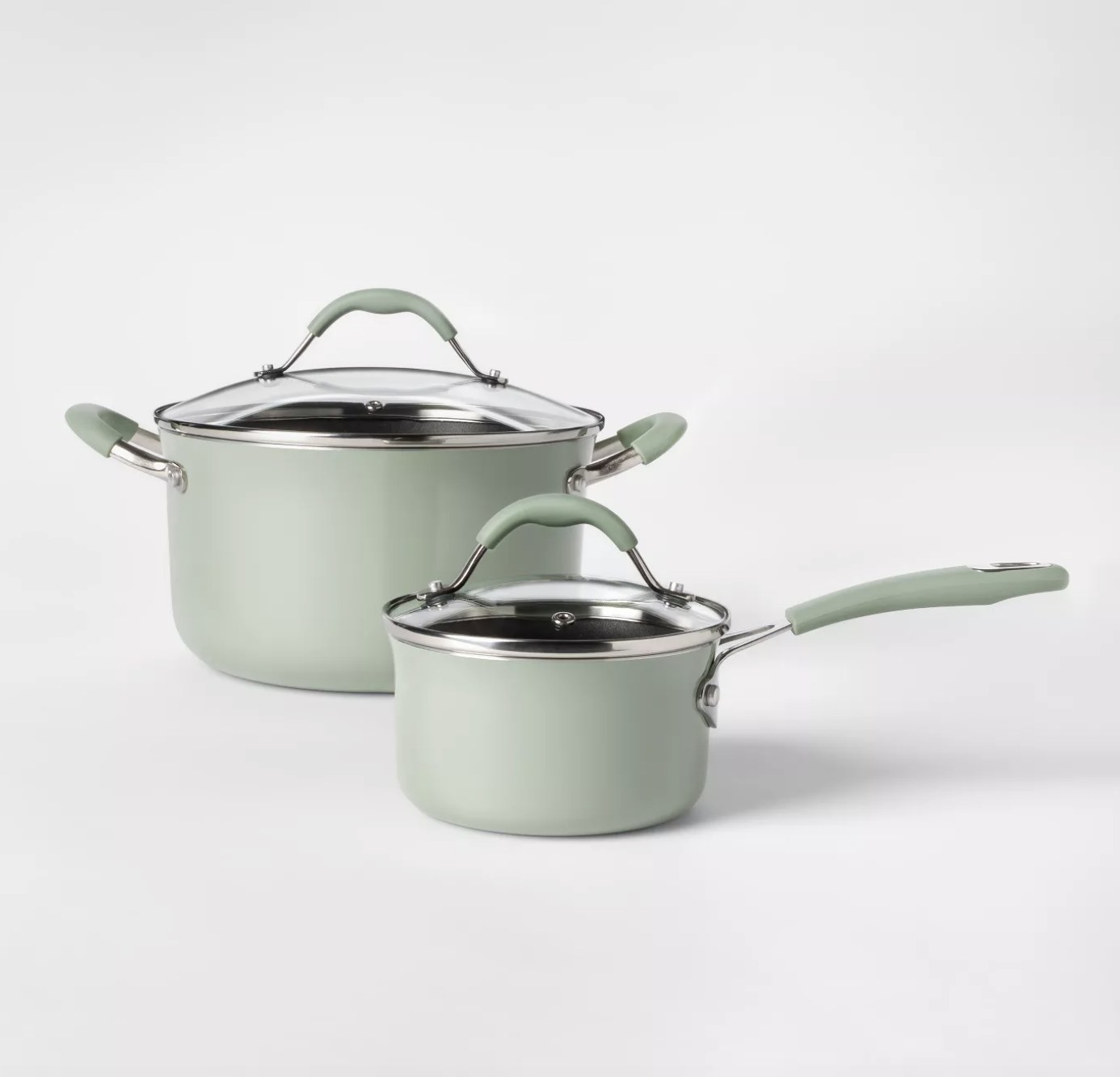 the dutch oven and sauce pan with lids in mint green