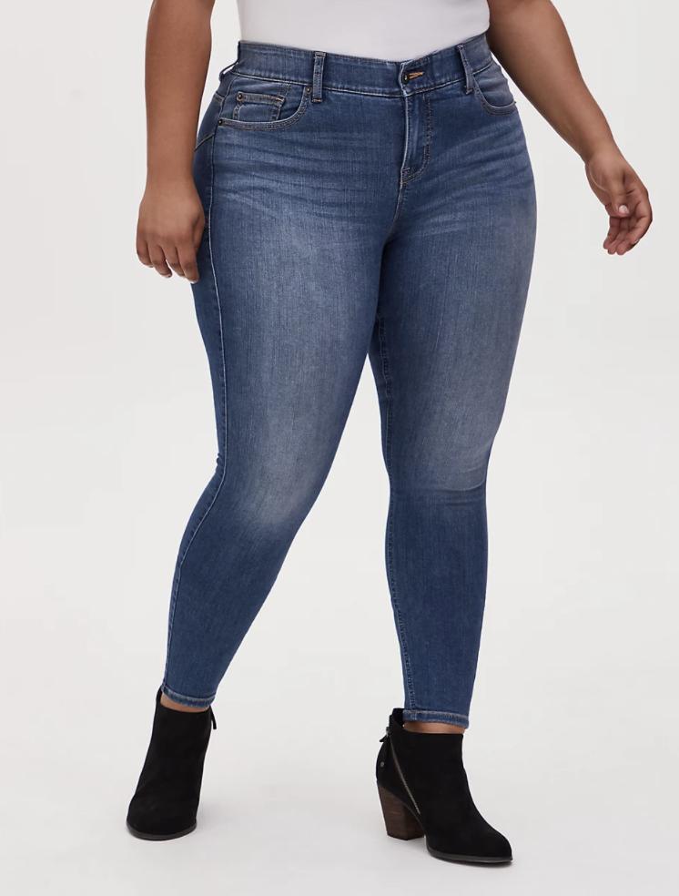 model wearing medium wash skinny jeans