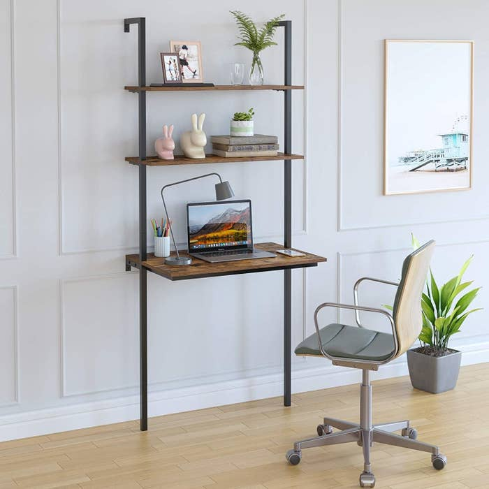 The wall-mounted desk which has a work area and two shelves