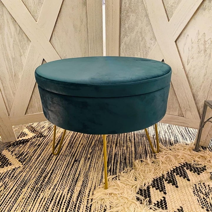 A reviewer's photo of the teal ottoman/table