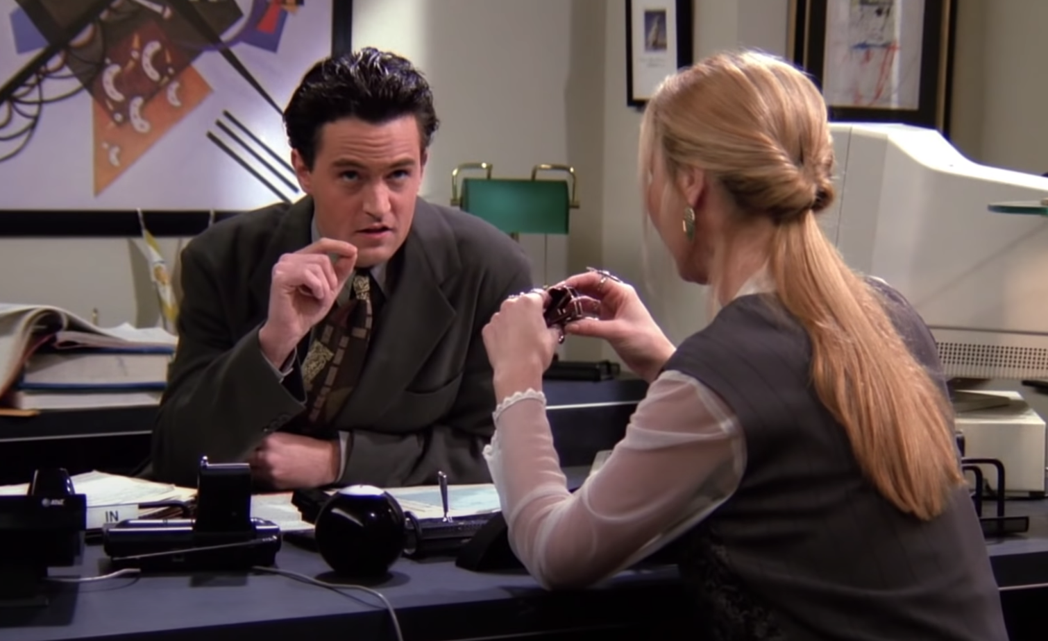 "Chandler and Phoebe from ""Friends"" in the office"
