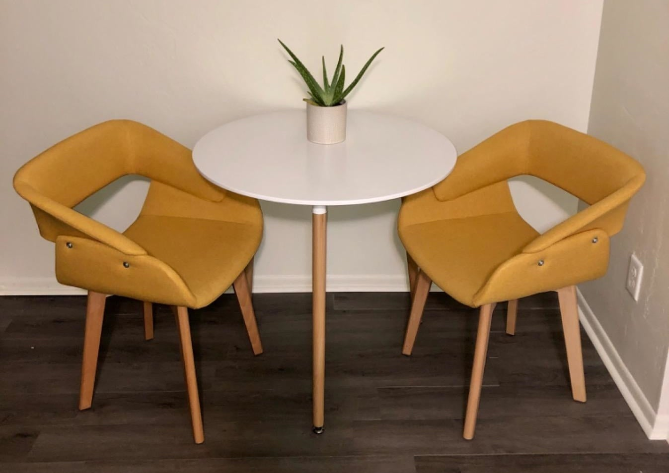 A reviewer's photo of the chairs in yellow