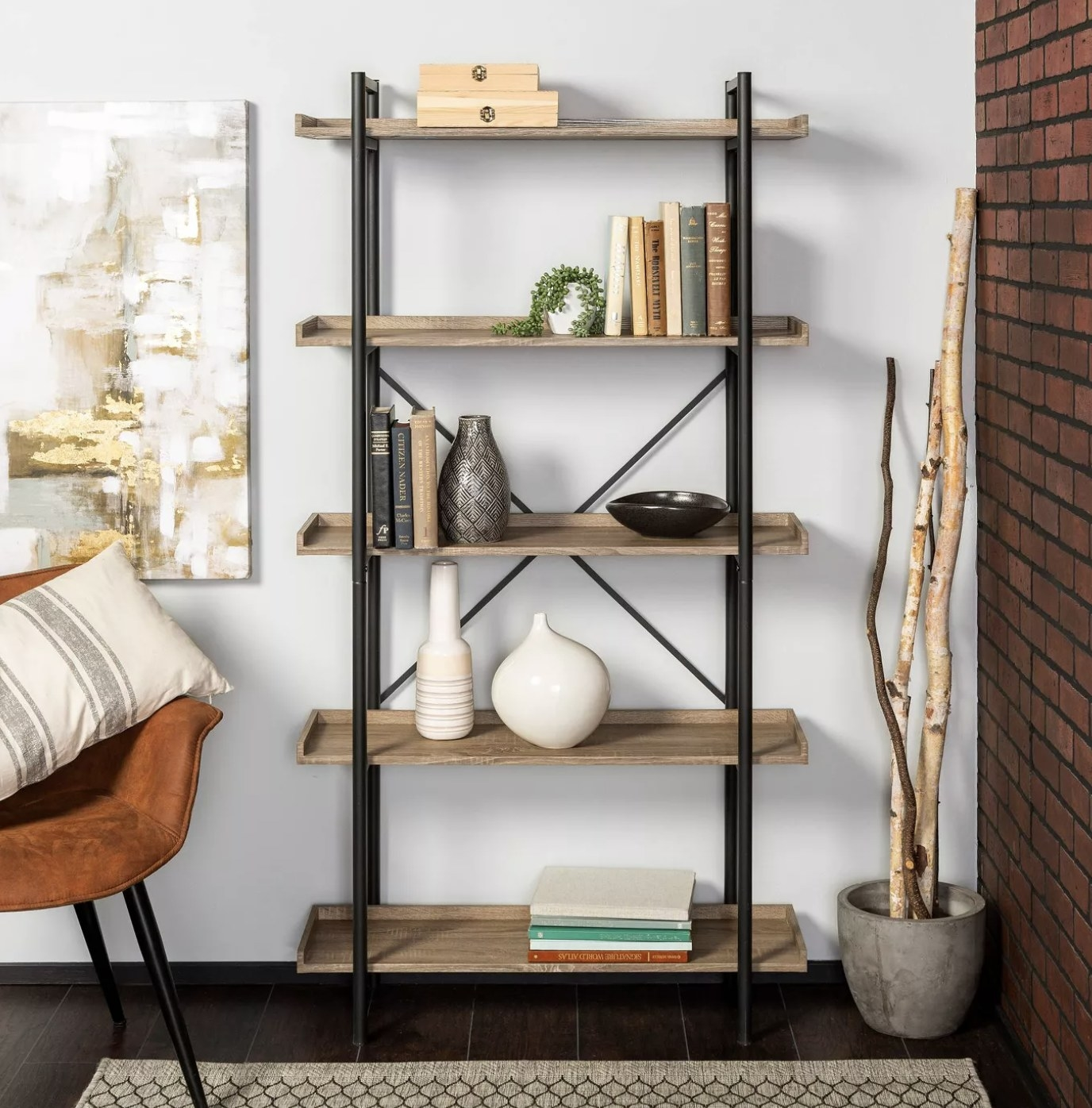 the bookshelf with wood shelves and black metal poles