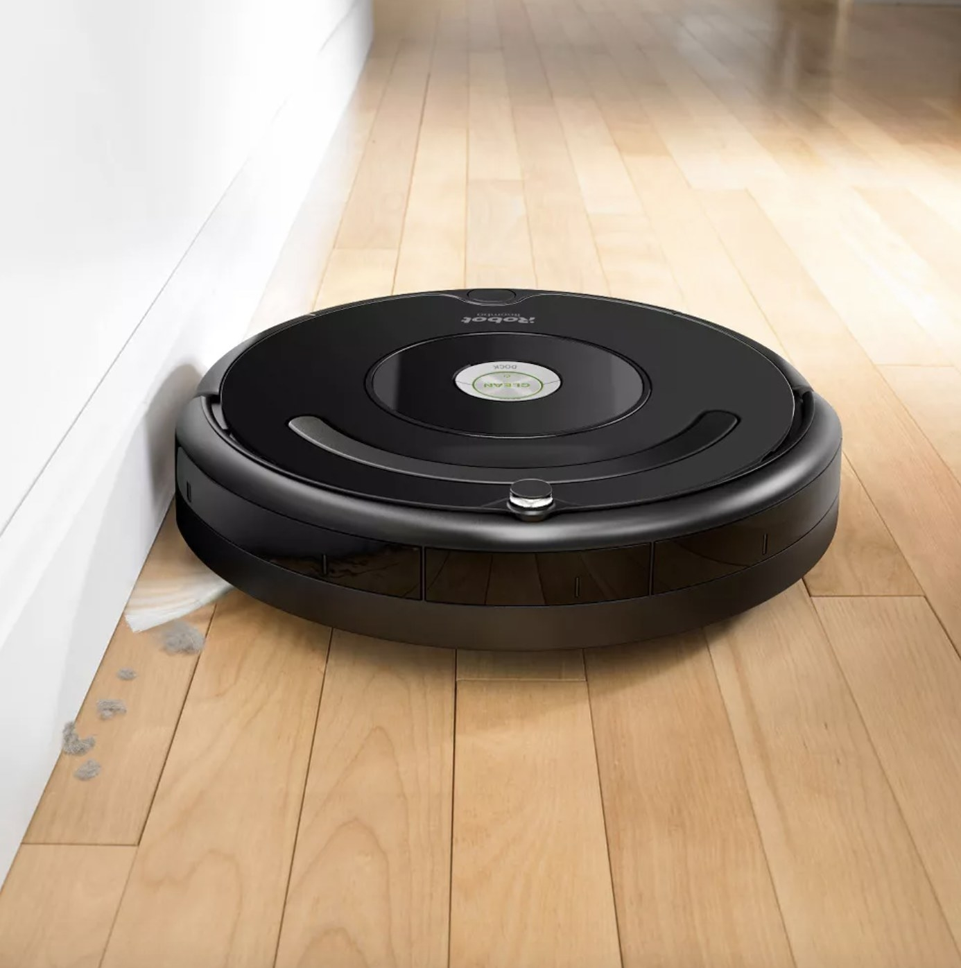 the robot vacuum cleaning up dirt