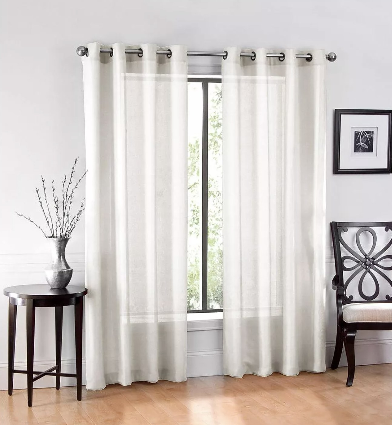 The white sheer curtain panels