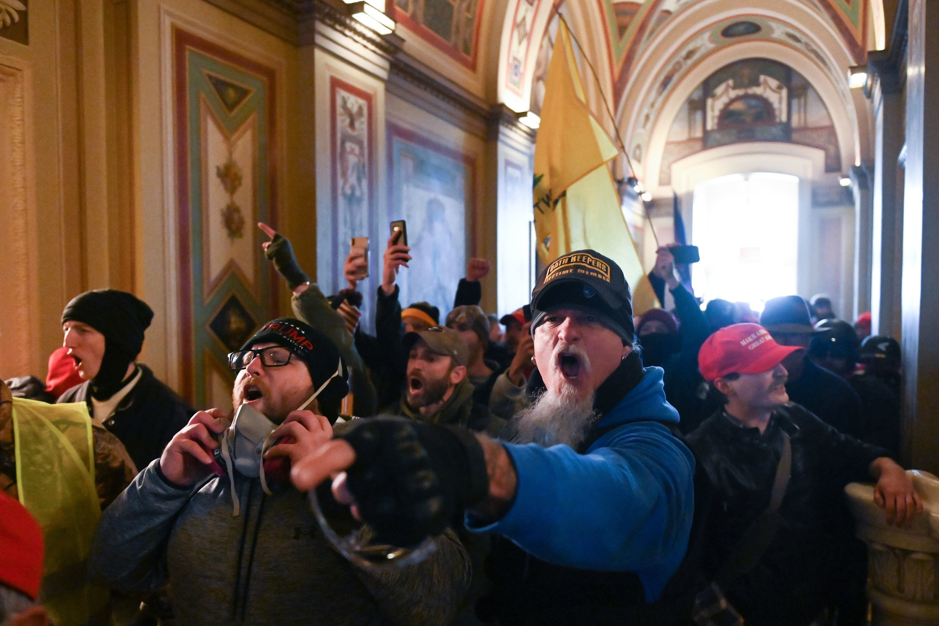 Supporters, many without masks, of US President Donald Trump yelling as they riot inside the US Capitol