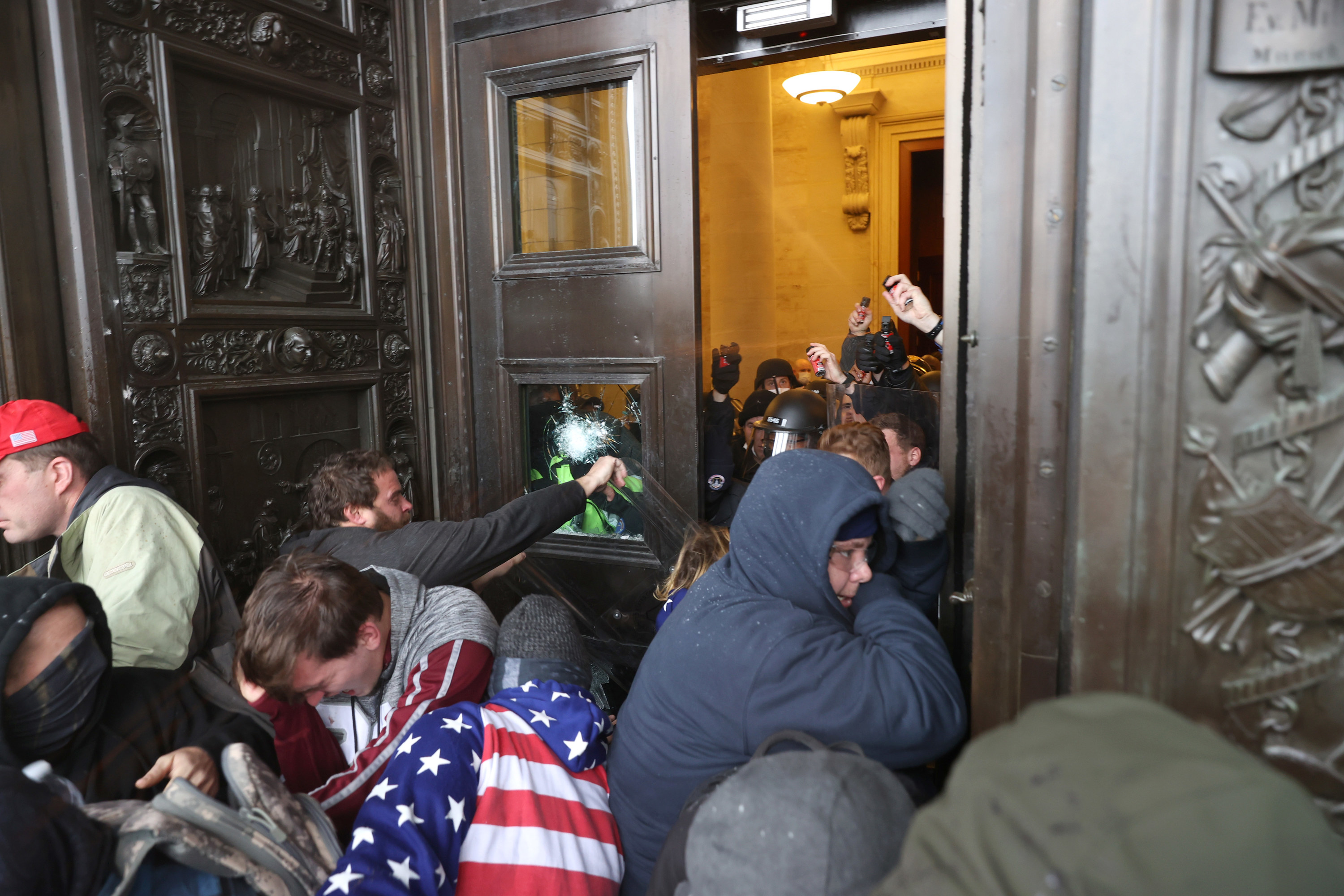 Protesters attempt to enter the U.S. Capitol Building