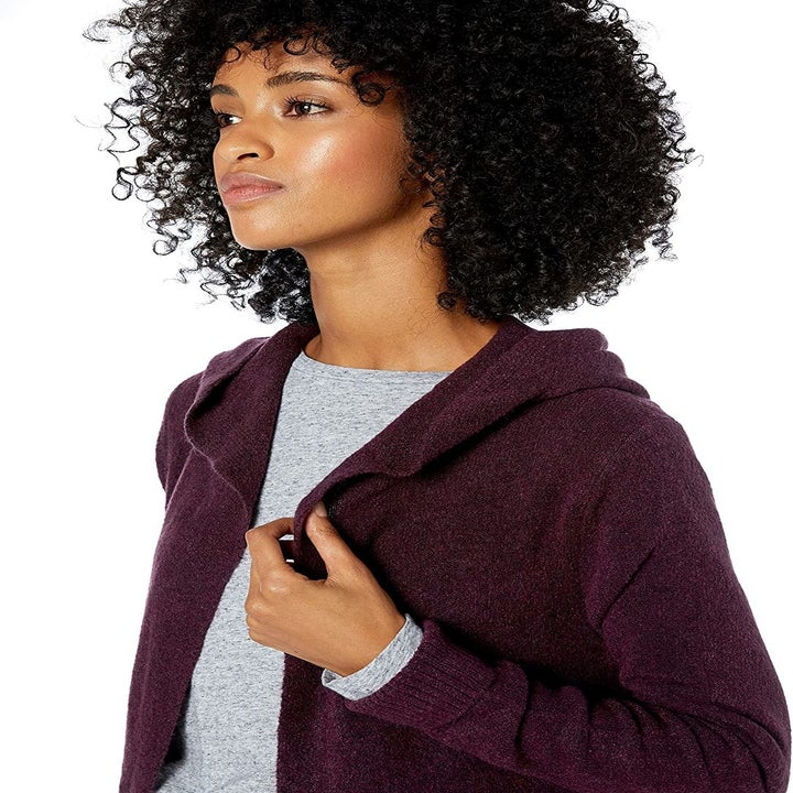 the same model in the hooded sweater in burgundy